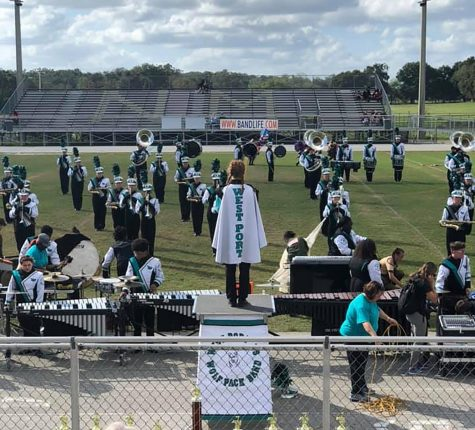 During the Fall, the West Port band prepares a marching show to compete in district competitions. On the podium is Dani O'Neal, Senior Drum Major to the band. The title of the band's show was