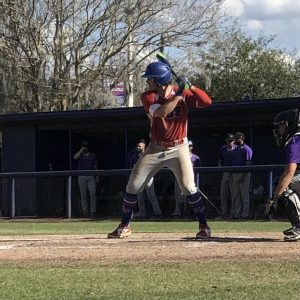 First baseman, Jackson Taylor, #24, bats in the bottom of the second inning. He would later double to right-field scoring Spencer Stephens #8 and Edrick Felix #2