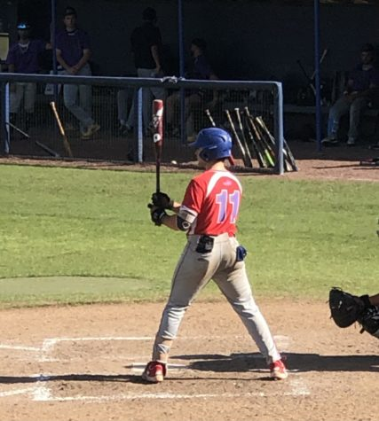 JC Mendez #11 stands in the box waiting for the pitch. The Patriots went on to drop game one in extra innings 10-9.
